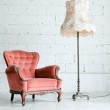 Armchair with desk lamp in vintage room — Stock Photo #12317087