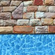 Modern stone pavement with pool background — Stock Photo #12419351