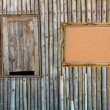 Cork board with vintage frame hanging on bamboo panal — Stock Photo