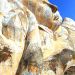 Giant reclining buddhface statue over blue sky — Foto de stock #12874967
