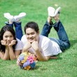 Young couple laying on grass together — Foto Stock