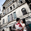 Bride and groom seeing each other at old building — Stock Photo