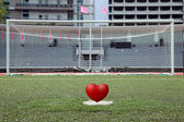 Perspective of penalty spot of soccer field with heart — Stock Photo