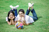 Young couple laying on grass together — Stock Photo