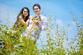 Portrait of couples with beautiful meadows — Stock Photo
