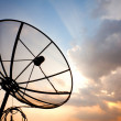Satellite dish over sunset sky — Stock Photo