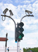 Surveillance Security Camera or CCTV with traffic light — Stock Photo