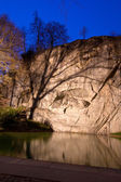 Dying lion monument in Lucern Switzerland twilight, vertical — Stock Photo