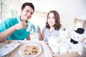 Young happy couples breakfast — Stock Photo