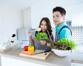 Happy couples in kitchen — Stock Photo