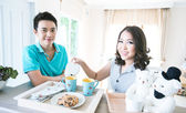 Couples with breakfast — Stock Photo
