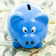 Piggybank on Dollar — Stock Photo