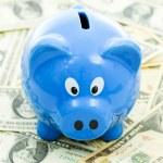 Piggybank on Dollar — Stock Photo