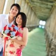 Stock Photo: Portrait of attractive couples under pier on beach
