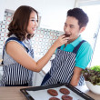 Couples in domestic kitchen with breakfast — Stock Photo