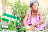 Mature woman is selling Thai traditional snack — Stock Photo