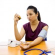 Womunhappy with blood pressure test — Stock Photo #27861781