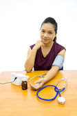 Woman happy with her self blood pressure test — Stock Photo