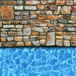 Stock Photo: Irregular stone pavement with pool background
