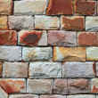 Red stone brick wall — Stock Photo