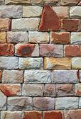 Red stone brick wall — Stock Photo