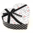 Perspective of isolated black and white holiday gift box in hear — Stock Photo