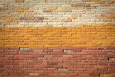 Mönster av färgstarka moderna tegelvägg dykt upp — Stockfoto