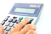 Human finger on tax button of calculator — Stock Photo