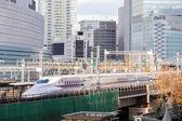 Tokyo railway with skyline — Stock Photo
