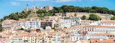 Cityscape of Lisbon and castle — Stock Photo