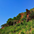 Rocky landscape in blue sky - Stock Photo