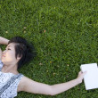 Young woman reading a book in the field — Stock Photo #12515706