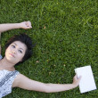 Young woman reading a book in the field — Stock Photo #12515965