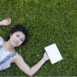 Young woman reading a book in the field — Stock Photo #12516733