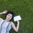 Young woman reading a book in the field — Stock Photo #12517097