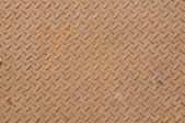 Rusty grunge texture on old metal diamond plate — Stock Photo
