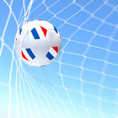 3d vykreslování xxxxx vlajky na fotbalový míč v síti — Stock fotografie