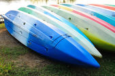 Colorful kayaks in stack — Stock Photo