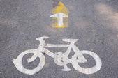 Bicycle symbol on city street — Stock Photo