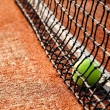 Tennis ball on a tennis clay court - Zdjęcie stockowe