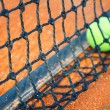 Tennis ball on a tennis clay court (Focus on net) — Stock Photo