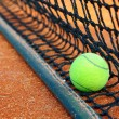 Tennis ball on a tennis clay court — Stock Photo