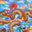 The golden dragon on the wall - Stock Photo