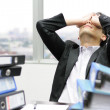 Thoughtful or stressful businessman at work — Stock Photo #45404731