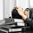Thoughtful or stressful businessman at work — Stock Photo #45404749