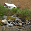 Creek and house — Stock Photo