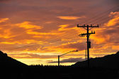 Sunset cloud with electricity line — Stock Photo