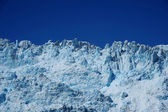 Blue glacier with blue sky — Stockfoto