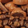 Assorted chocolate candies and coffee beans — Stockfoto