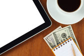 Tablet pc, notepad, pen, money and cup of coffee — Stockfoto
